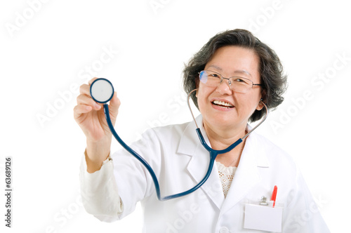 Asian senior female doctor holding stethoscope