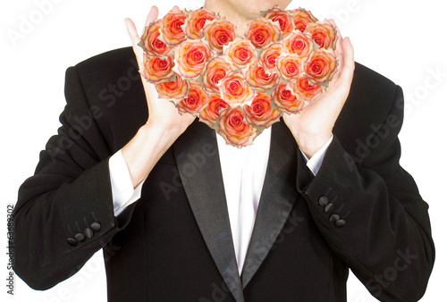 Man in  Tuxedo with Heart Flower Roses.Love.Wedding
