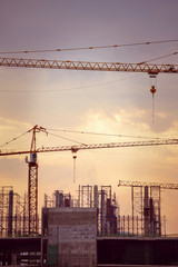 Construction site with cranes, retro tone image