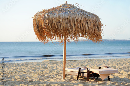 Beach chair and umbrella - 63689799