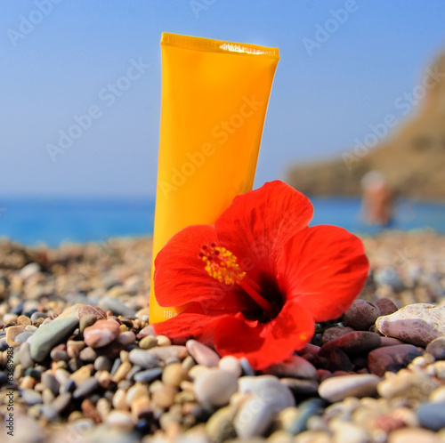 Stack of pebbles, cream and flower at the beach