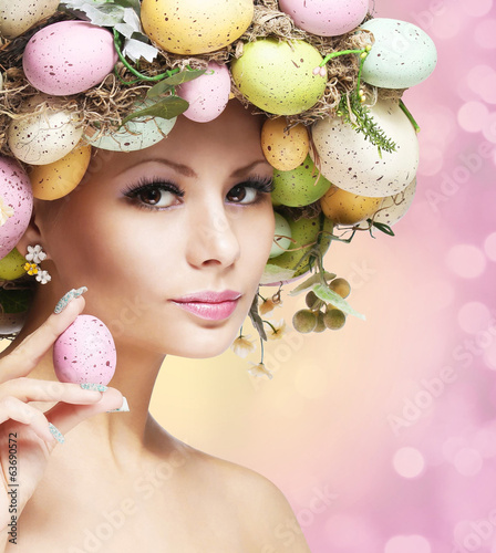 Leinwandbild Motiv Easter Woman. Spring Girl with Fashion Hairstyle.