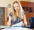 Blonde woman fills in documents