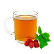 Tea with raspberry in glass mug