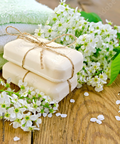 Soap with towel and bird cherry on board