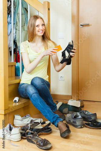 canvas print picture Happy  housewife with shoes