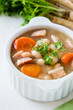 White bean soup made of  beans, carrot and ham