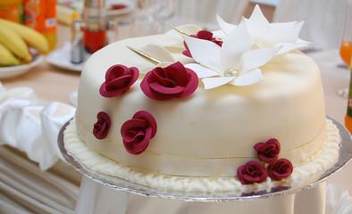 white wedding cake with roses