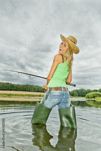 woman fishing in pond