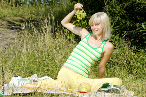 woman with grape at a picnic
