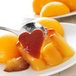 creme caramel and peach in syrup