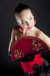 portrait of a ballet dancer holding a fan