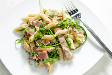 penne pasta with Parma ham and ruccola