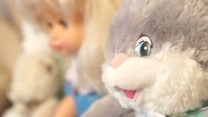 a baby doll and a toy hare