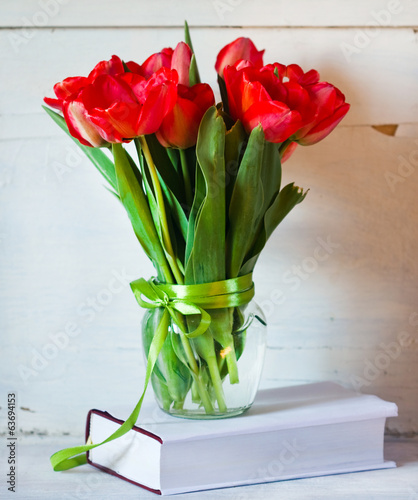 bouquet of tulips in a glass jar