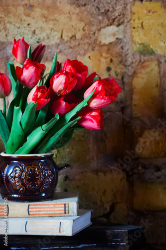 bouquet of tulips and old books