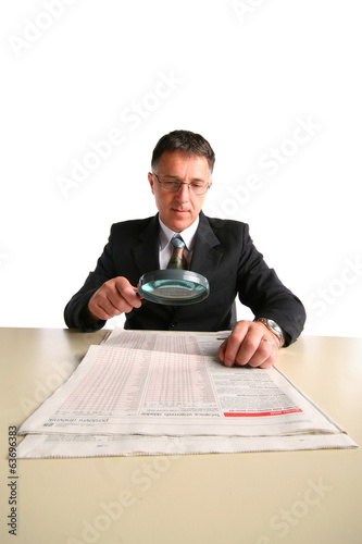 Business man at the table inspecting his results