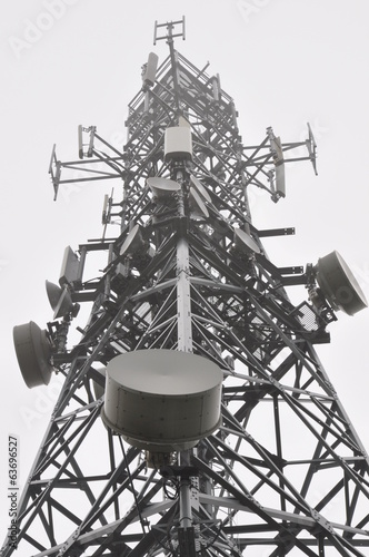Telecommunication tower with antennas in the mist