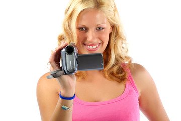 Attractive blonde girl recording with video camera