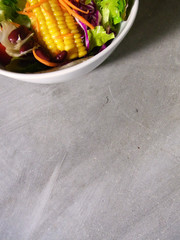 mixed salad bowel on cement background