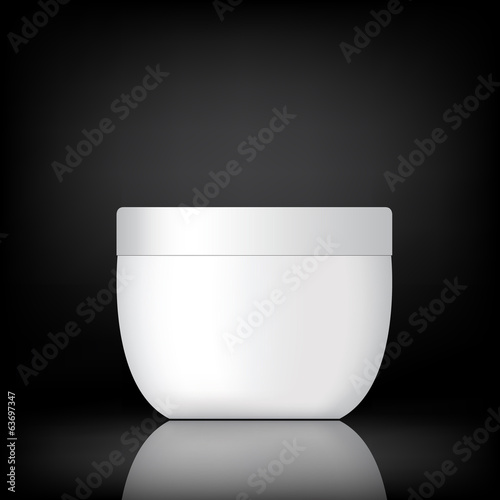 cream container on black background
