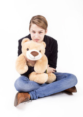 Portrait of the beautiful teen with teddy