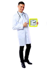 Portrait of a male doctor showing on clock over white background