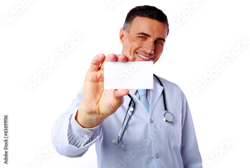 Happy male doctor holding blank card