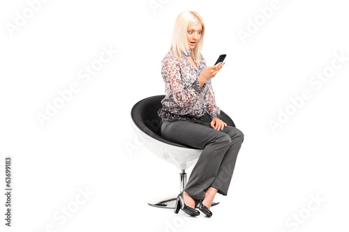 Stylish woman looking at a cell phone
