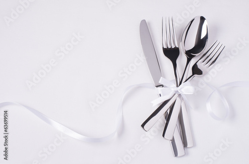 Glossy silverware on white background