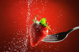 Strawberry on a fork punctured falling sugar detail poster