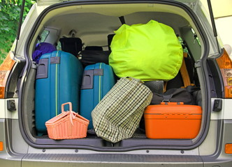 suitcases and many bags in the car
