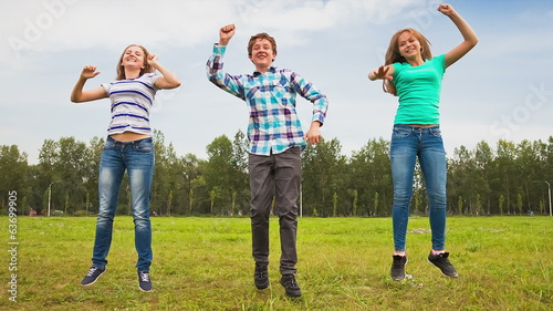 Teens Dancing in a Meadow