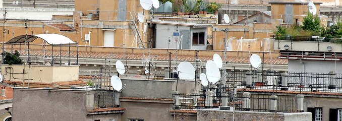 roofs of the metropolis with lots of antennas and antenna