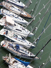 yachts and motor boats moored in the prestigious Harbour
