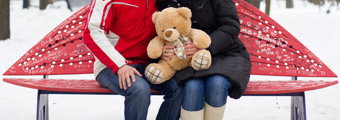 Happy couple with teddy bear