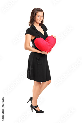 Woman holding a red heart