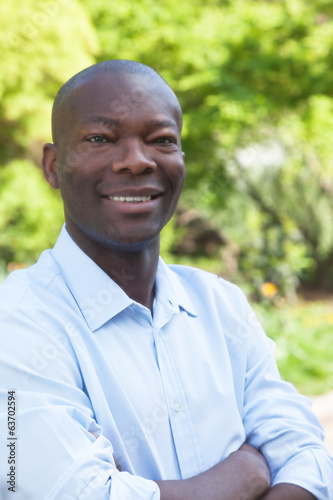 African man with crossed arms looking at camera