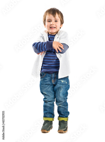 Kid with his arms crossed over white background