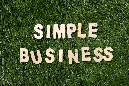 Simple Business Wooden Sign On Grass