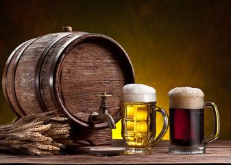 Beer glasses, old oak barrel and wheat ears.