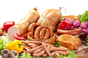 Variety of sausage products with vegetables. Clipping path.
