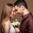 Beautiful couple in love with bouquet flowers.Valentine's Day