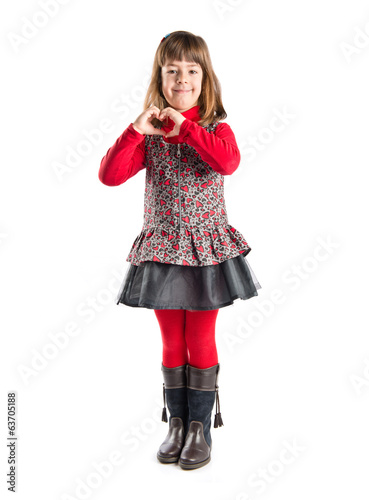 Young girl make a heart with her hands over white background