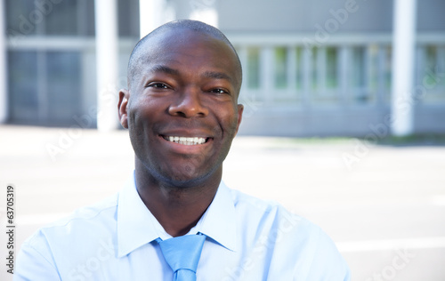Portrait of an african businessman in front of his office
