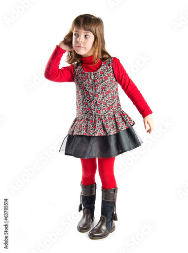 Girl in black clothes listening over white background