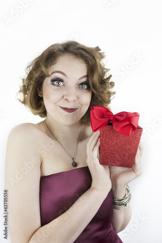 Cute young woman holding gift