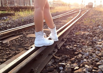 Walking along the railroad in evening