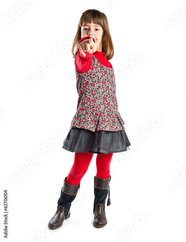 Child pointing to front over white background