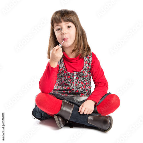 Child sitting on de floor over white background